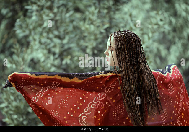 Young woman dancing with scarf - Stock Image