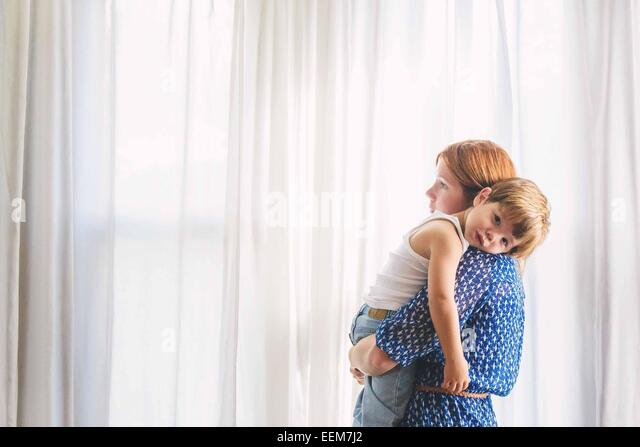 Portrait of a mother carrying her son - Stock Image