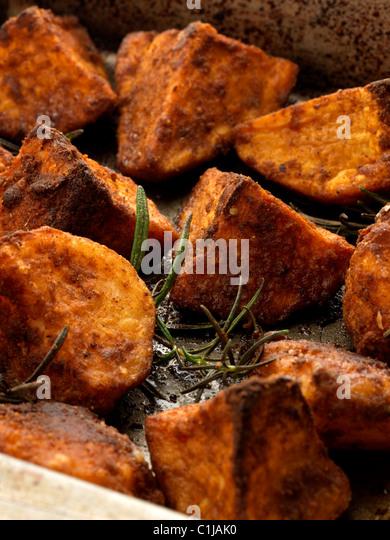 Roast potatoes and sweet potatoes - Stock Image