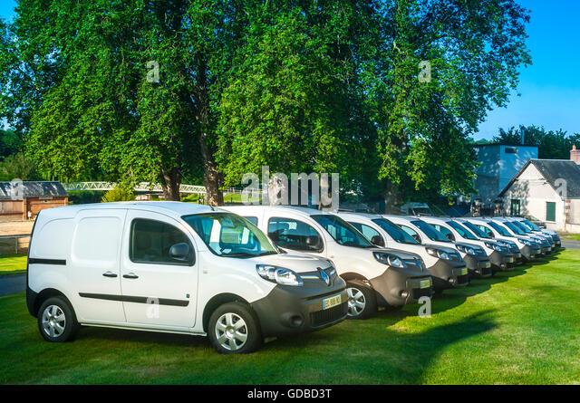 Line of ten Renault ZE Electric vans - France. - Stock Image