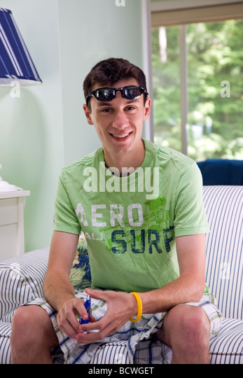 Portrait of 20 year old male in a vacation condominium in Wells Maine USA - Stock Image