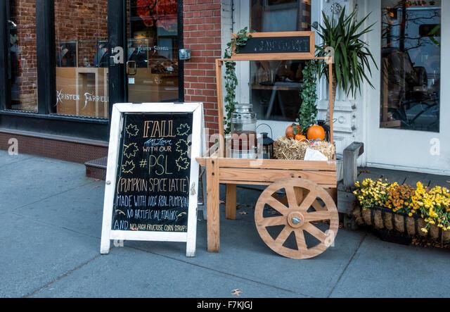 PSL (Pumpkin Spice Latte) for sale outside a bar restaurant in Soho in New York City - Stock Image