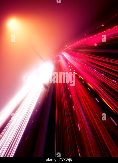 Colorful light trails of busy highway traffic on a foggy night, Highway 401, Toronto, Ontario, Canada. - Stock Image