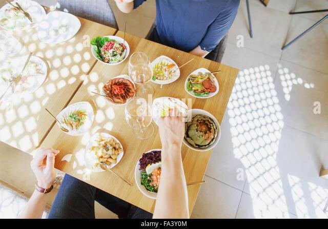 High angle view of couple having meze at Lebanese restaurant - Stock-Bilder