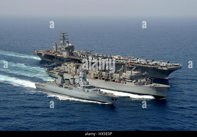 German navy frigate FGS Hamburg (F220), aircraft carrier USS Dwight D. Eisenhower (CVN 69), and Military Sealift - Stock Image