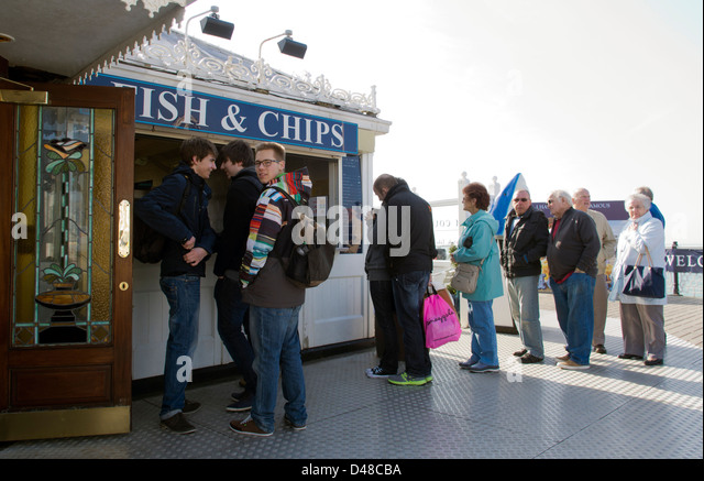 Queueing in the sunshine for fish and chips on Brighton pier, East Sussex, UK - Stock Image