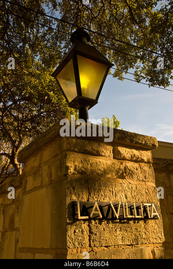 La Villita entrance sign street lamp stone wall historic arts village san Antonio texas tx tourist attraction shopping - Stock Image
