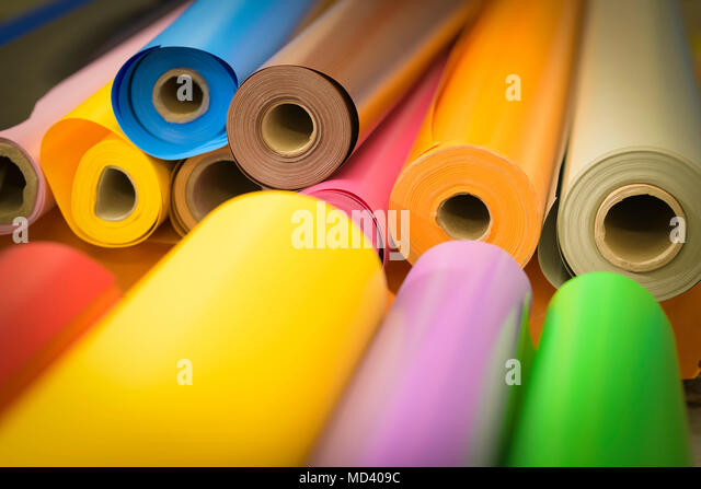 Rolls of colourful vinyl in factory - Stock Image