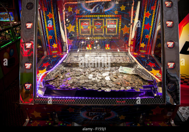 Coin pusher gambling machine - Stock Image