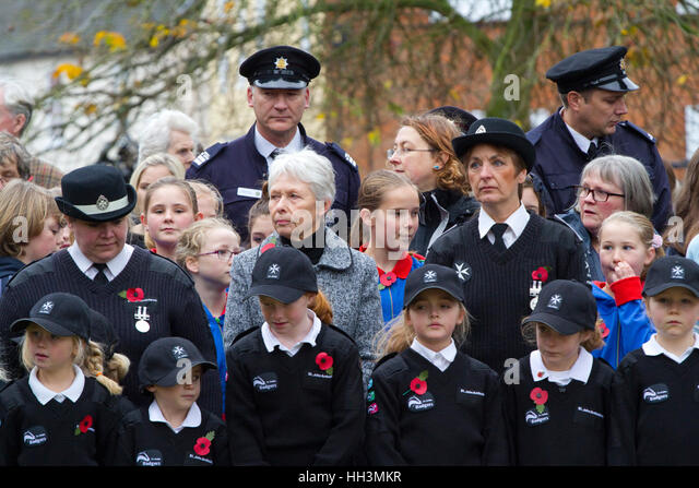 St John Badgers, Girl Guides and Retained Firefighters at a British Legion Remembrance Day Parade - Stock Image