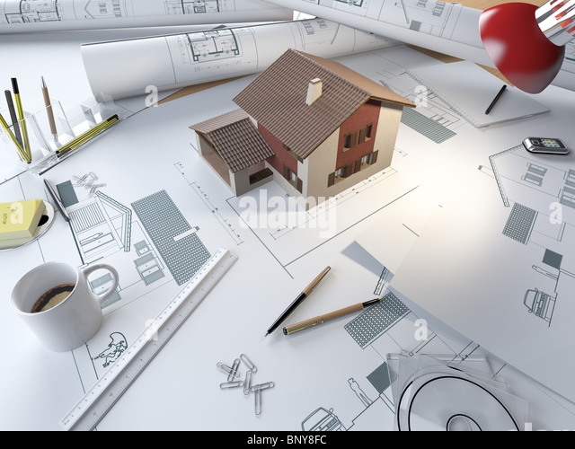 drawing table of an architect with plans and 3d model of a house - Stock Image