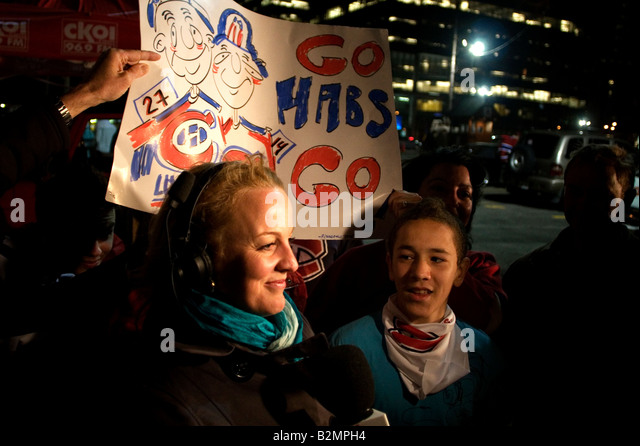 Montreal Canadians fans stand outside the Bell Center in Montreal - Stock Image