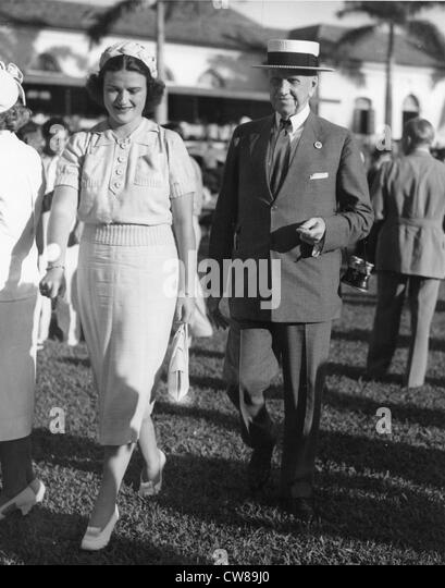 Mollie Cullum with Edward R. Bradley, Hialeah Racetrack,, 1938 - Stock Image