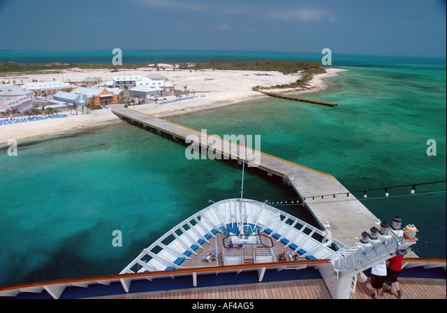 cruise ship dock Grand Turk Island cruise port bow of ship overlooks green caribbean sea - Stock Image