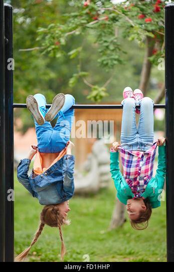 Happy girls spending leisure on recreational facilities - Stock Image