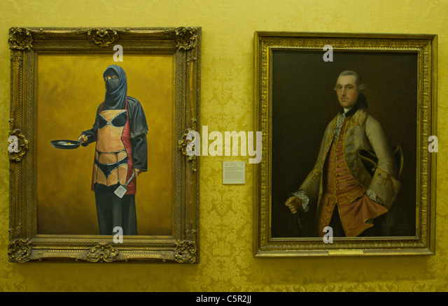 Banksy picture of traditional portrait of aristocrat and muslim woman with full veil and 'bikini' apron - Stock Image