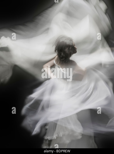 A young woman dancing with a white dress - Stock-Bilder