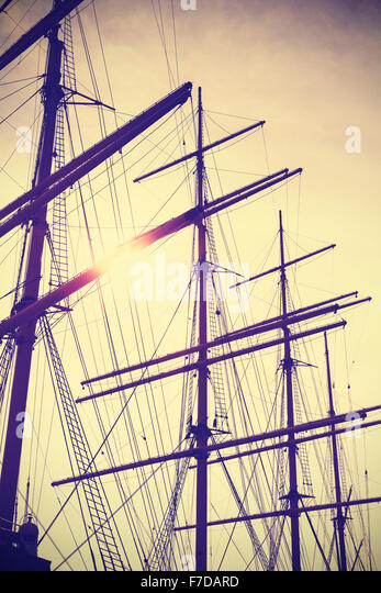Retro vintage toned sailing masts at sunset, travel concept. - Stock-Bilder