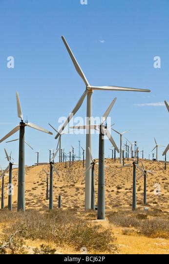 Energy generating windmills on desert hill against sky Palm Springs California USA Coachella Valey - Stock Image