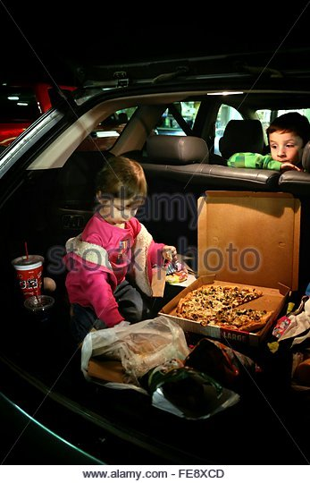 Children In Car With Pizza - Stock Image