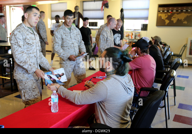 Marines receive autographs from Impact wrestling stars, Jeff Hardy, A.J. Styles, Brooke, and Gunner, at The Great - Stock Image