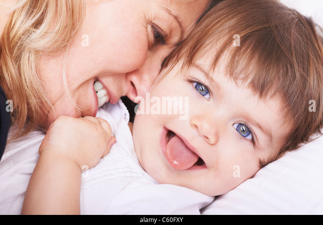 Mother and daughter playing - Stock Image