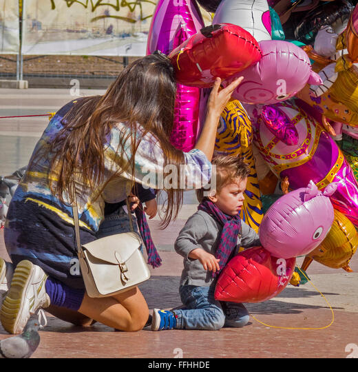 Mother and Child Choosing A Balloon Barcelona Spain - Stock Image