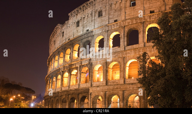 Colosseum in Rome lit up at night - Stock Image