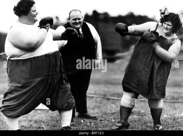 Fat women boxing, historic photograph, around 1910 - Stock Image