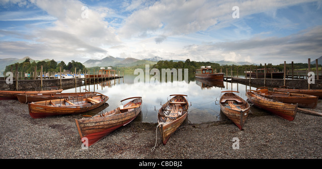 Panoramic landscape image of the rowing boats moored beside Lake Derwent Water, at Keswick in Cumbria, UK, Europe - Stock Image
