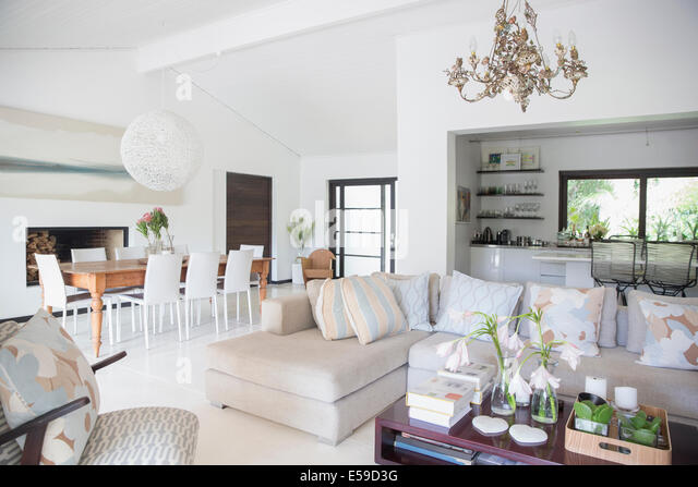Sofa and dining table in modern living area - Stock-Bilder