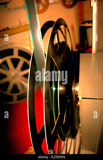 Royalty Cinema inside projection room & projectionist & projector - Stock Image