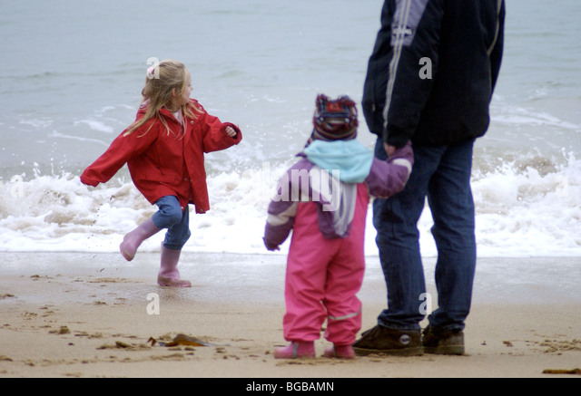Photograph of family unit together secure beach safe kids dad UK - Stock-Bilder