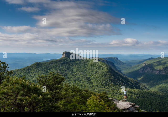 Woman Power Posing with Table Rock Mountain in Background in Linville Gorge - Stock Image