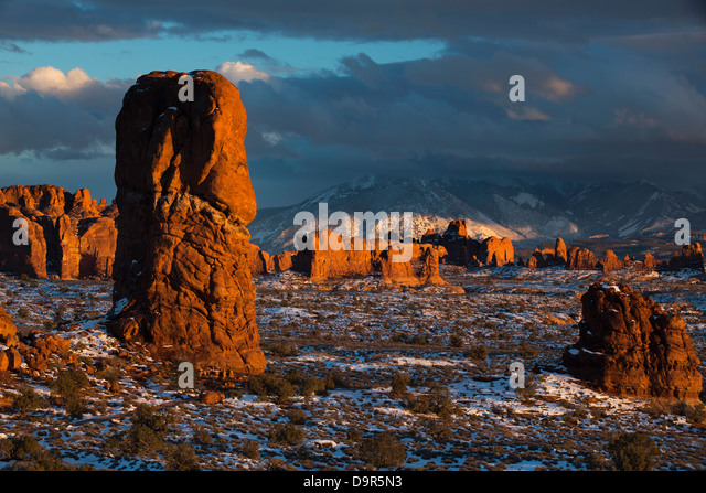 Balanced Rock and the Windows Section with the La Sal Mountains beyond, Arches National Park, Utah, USA - Stock Image
