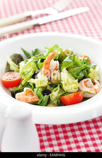 Italian cuisine shrimps and rucola salad - Stock Image