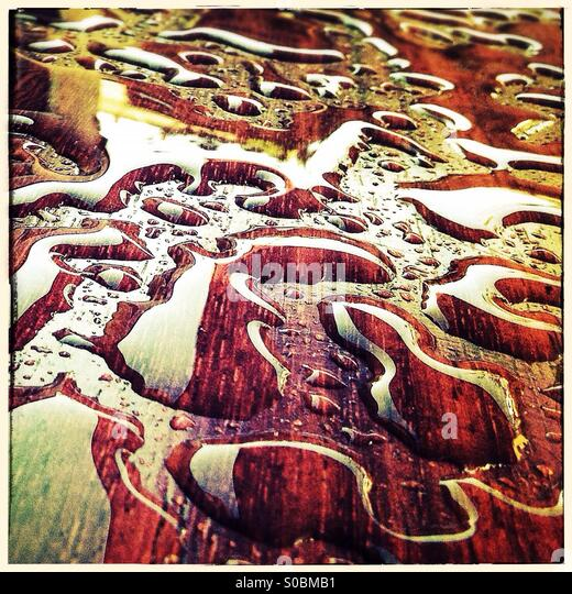 Water drops on a table after raining that seems jigsaw puzzle pieces - Stock Image