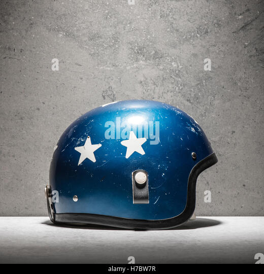 Vintage motorcycle helmet, blue with white stars. Still life of classic protective wear to be used for racing or - Stock-Bilder