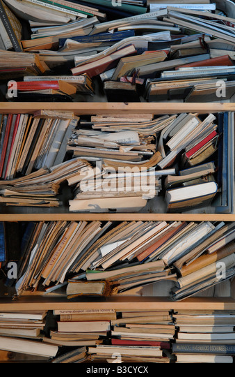 Books and Magazines on Shelves, close-up - Stock Image