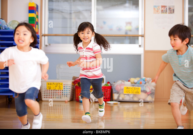 Children Running at Day-care Center - Stock Image