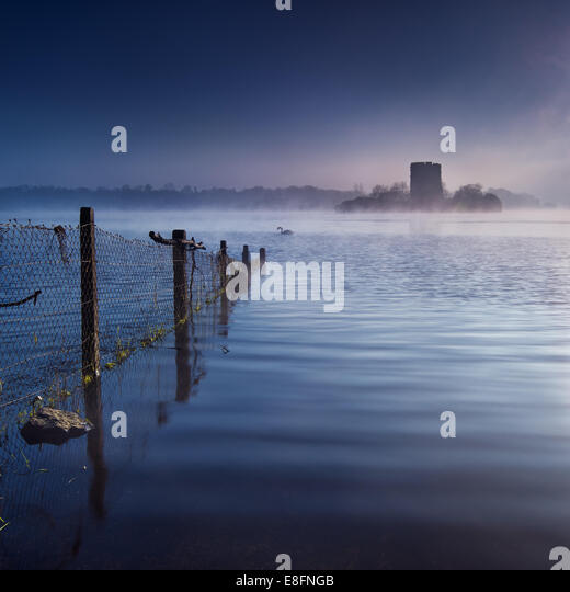 Ireland, Clough Oughter Castle, Peaceful morning at lake - Stock Image