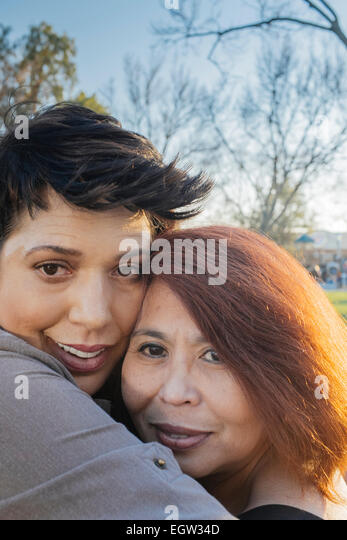 Two friends hugging. - Stock Image