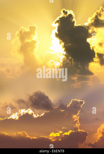 A dramatic sky and clouds at sunset - Stock Image