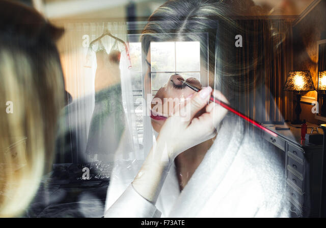 Applying make up to bride - Stock Image