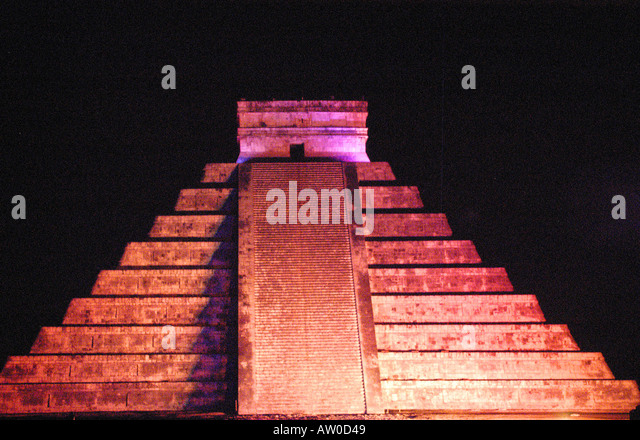 Chichen Itza El Castillo pyramid sound light show night nighttime Yucatan Mexico mx dark background red color - Stock Image