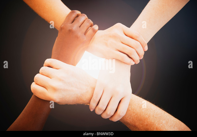 Four hands holding wrists of other people - Stock-Bilder