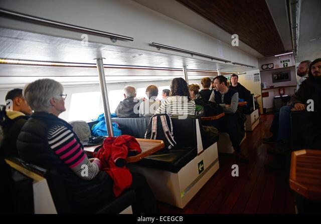 Visitors travel to Mykines island in ferry called Jósup, Faroe Islands - Stock-Bilder