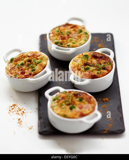 Individual pea and ham flans - Stock Image