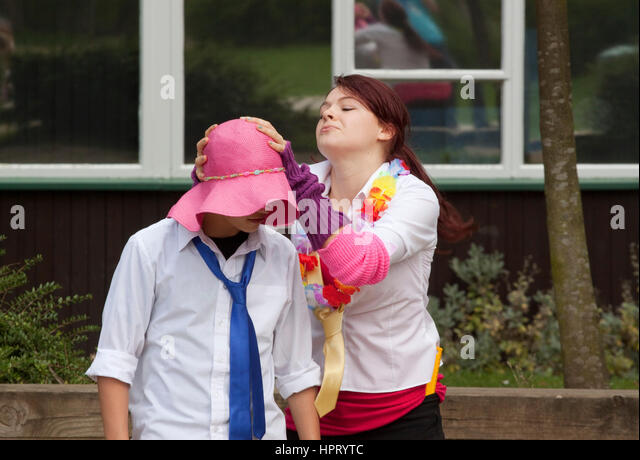 The dress rehearsal for a school/teenage promenade production of Romeo and Juliet - Stock Image