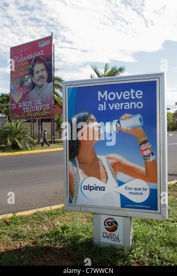 Nicaragua Managua Calle Colon street scene billboard ad marketing Spanish language alpina brand bottle water hydration - Stock Image